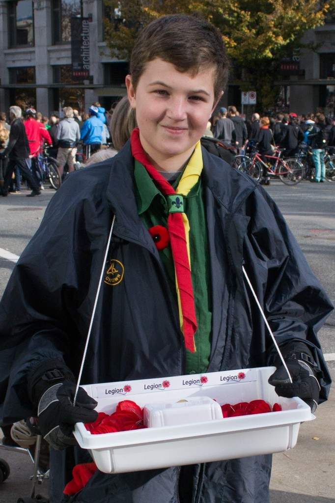 Photo by: Pamela Rubio / Boy selling poppies on Remembrance Day in Vancouver, B.C., Canada
